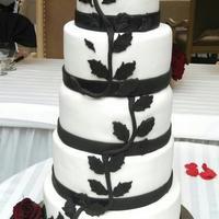 Black & White Wedding Cake With Black Magic Roses I made this 5 tier cake for a friends Wedding yesterday. It's Vanilla cake with Whipped Cream and Strawberries filling and iced with...