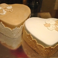 Double Heart Lace Anniversary These cakes were made for two friends who shared the same Anniversary date! 32yrs and 14yrs! Red Velvet with Bourbon Cream Cheese. Used GSA...