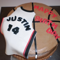 Basketball/heat Jersey Chocolate cake with chocolate/peanut butter, buttercream fondant accents...