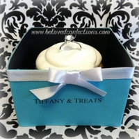 Tiffany & Co. Bridal Shower Cupcakes I made each box from tagboard, scrapbook paper, and ribbon.... took a long time but well worth it! Faux ring (non-edible) on top of simple...