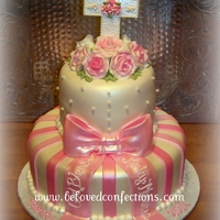 Pretty In Pink Baptism Cake Created from a picture that was given to me by the customer. Gumpaste flowers and handcrafted cross. TFL!