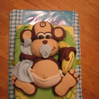 Baby Monkey A cake that fought me the whole way!!! But I am happy with how it turned out :-) All MMF decorations and RKT monkey covered in MMF. The...