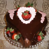 Chocolate Love Decadent chocolate cake with bavarian creme/chocolate ganache filling along with one layer of raspberry filling. Covered by chocolate...