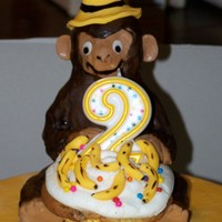 Curious George B-Day Cake I realized too late the yellow hat was too small - but the two year old new right away who was on his cake - so that is all that matters to...