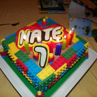 Lego Cake For My 7 Yr Old Grandson.... He Loves Lego's chocolate cake with chocolate frosting, lego's made from candy melts. Lettering is fondant. TFL