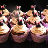 Minnie Cupcakes   Chocolate ganache filling cupcakes...topping is strawberry ganache with minnie decor..
