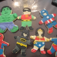 Superhero Cookies Sugar cookies decorated with a fondant/candy clay mix.