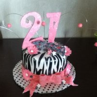 Zebra 21St Birthday!!!  Layers of brownie and vanilla sponge cake soaked in framboise with fresh raspberries and vanilla swiss buttercream...covered in fondant...