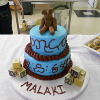 Vintage Toys Baby Shower Cake WASC cake with almond buttercream. It's topped with a fondant bear and has some wooden blocks on the table.