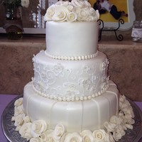 Ivory Chocolate Roses Wedding Cake Beautiful White Chocolate Roses top and bottom of this wedding cake