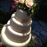 Fondant Wedding Cake Four Tier Four Tier Wedding Cake Ivory Fondant with Ribbon and flowers