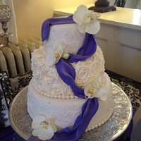 Fondant Cake With Purple Draping Three tier fondant cake with purple draping and pearls flowers