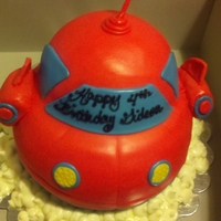 "Einsteins This is just a 8"" round cake shaped into the toy. Buttercream clouds"
