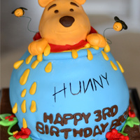 Winnie The Pooh Pooh's head is rkt, all decorations are fondan, Board is covered in chocolate fondant and imprinted with woodgrain(hard to see in...
