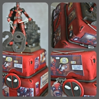 Deadpool Cake toy on top, comic strips are edible image