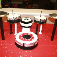 Rock Star Drumset Cake Bass, two snares & seat are all cake. Was hard getting bass to stand upright, but I rigged it with plates! haha