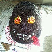 Skull Cake Okay..so this was my attempt at a 3D skull cake with NO mold! He wanted it all black (which to me makes it look like an ape) ha & scary...