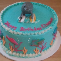 Manatee Cake for a girl who loves manatees! Her mom gave me her toy manatee to add to the cake. I put it on some sugar surfboards with some tropical...