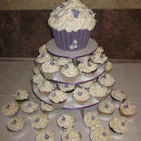 Purple Cupcakes Cupcake stand with giant cupcake in chocolate liner.