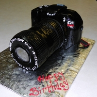 Canon Rebel T2I Camera Cake made body of camera using loaf pan and carved. iced in bc and covered in mmf. written detail in royal icing and other detail in mmf. the...