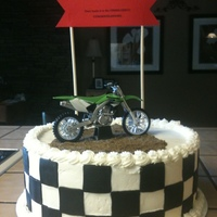 Dirt Bike Grad Cake Grad loves dirt bikes. Chocolate cake with cream cheese filling. Buttercream frosting. Duff black fondant squares. Finish Line sign is just...