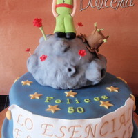 The Little Prince (El Principito) Taken from the book, The little prince. Little Prince is made of modelling paste.Asteroid is rice krispie treats, and the cake is...