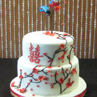 Double Happiness One of my favorite wedding cakes to date! Birds are cold porcelain and hand painted. Tree branches are thinly rolled modeling chocolate and...