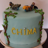 Lego Chima Lego Chima cake. Fondant with buttercream decorations.Real lego chima speedorz on top.