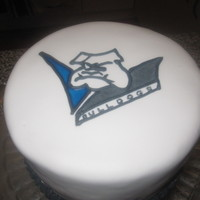 Cantebury Bulldogs A quick cake made at Christmas in Qld- hot weather so struggled keeping the fondant cool. piped the logo on with royal icing- flooding the...