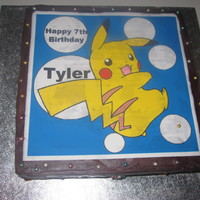 Pikachu Cake Ganached cake with edible image. Tyler helped my decorate with the cashous. This was all he wanted this year so I happily obliged :)