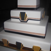 White/black/gold- 4 Tier A faux cake for an engagement party. Real ribbon. Fondant art deco decorations
