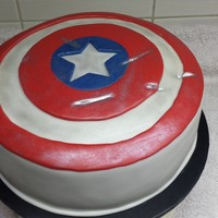 Captain America Shield All fondant with shimmer dust to enhance the dents.