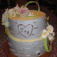 A Rustic Wedding Cake Made To Look Like Birch Bark All Buttercream Except The Flowers And Leaves Are Gumpaste A Rustic wedding cake made to look like Birch bark. All buttercream except the flowers and leaves are gumpaste.