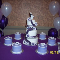 3 Tier Wedding Cake With 6 Satelite Cakes WEDDING CAKE WHITE/PURPLE-3 TIER WITH 6 SATELITE CAKES WITH FONDANT FLOWERS