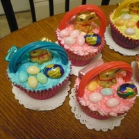 Cupcake Baskets   STRAWBERRY CUPCAKE TWIZZLER HANDLE WITH EASTER TREATS