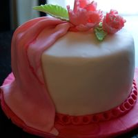"Wilton Class Pink Fondant Cake From my Wilton Fondant and Gumpaste class. My first try at draping and making the ""fantasy flower."""