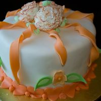 Orange Extravaganza This cake dummy is from my Wilton Fondant and Gumpaste class. We dusted the carnations with luster dust on the edges of the petals, but I...