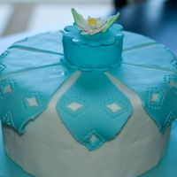 Handkerchief Cake This is a cake dummy from the Wilton Fondant and Gumpaste class. We used the fondant punch to make the diamond shape cut outs. The topper...