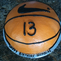 "Basketball ""cookie""ccake This basketball cake was actually made with layers of chocolate chip cookies for a boy who doesn't like cake"