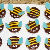 Bumble Bee Cupcakes Chocolate cupcakes covered in chocolate glaze. Stripes are fondant, wings are candy melts, stinger is a chocolate chip, and eyes are royal...