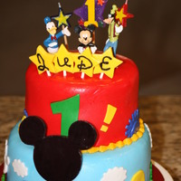 Mickey Mouse Clubhouse For a little boy who was turning one. His mom gave me a photo of a cake that she wanted me to copy. All fondant except for plastic toppers...