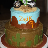 Dirt Bike Cake My nephew loves to ride his dirt bike in the desert so I made this for his birthday. Buttercream with fondant accent