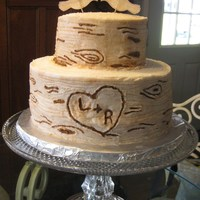Tree Stump Wedding Cake All Buttercream. Airbrushed color and carved designs with toothpick before filling in with brown food coloring