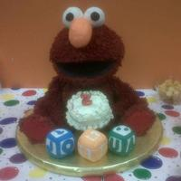 3D Elmo I made this creation for my son. It is a combination of cake and RKT. The head and body are cake. The arms and legs are RKT. TFL.