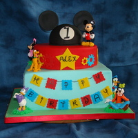 Mickey Mouse 1St Birthay French vanilla with strawberry filling. The MM hat on top is rice cereal treats. The figurines are plastic (don't mess with Disney),...