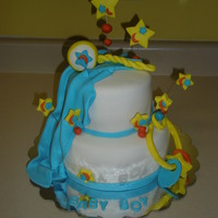 Baby Boy Colors matched invitation of Baby shower. Chocolate cake with peanut butter buttercream covered in MMF. Blanket, baby toy, rattle, and...