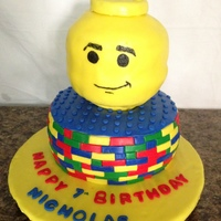 "Lego Birthday Cake This is a Cake I made for my Sons 7th Birthday. The Lego head is made with 6"" round cakes and the base is an 8"" round. Thanks for..."