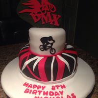 This Bmx Themed Cake Was For My Sons Birthday The Silhouettes Were All Hand Cut The Black Ones From Sugar Paper And The Red Was Rolled Fon... This bmx themed cake was for my sons birthday. The silhouettes were all hand cut. The black ones from sugar paper and the red was rolled...