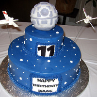 "Isaac 12"" white cake and 6"" chocolate cake covered in vanilla buttercream. Death Star is a styrofoam ball covered in fondant. X-wing..."