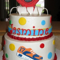 Jasmine Mom ordered this cake for her high school daughter who runs track and loves Elmo. Kind of strange, I know, but they liked it!